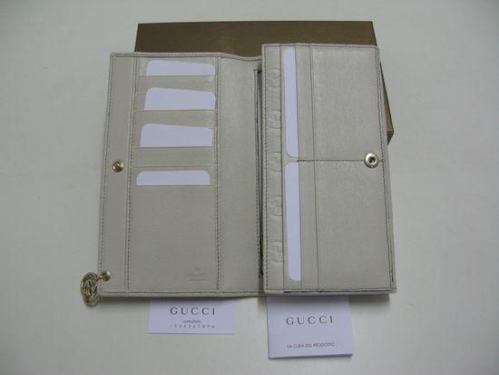 2009年gucci花纹白色长款钱包